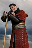 Knight holding axe. On a sky background Royalty Free Stock Photos