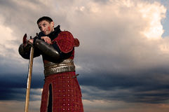 Knight holding axe. On a sky background Stock Photo