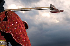 Knight holding a bloody axe. Photo of a Knight's shoulder on which he holds a bloody axe Royalty Free Stock Photo