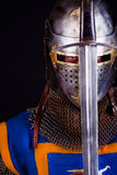 Knight holding sword Stock Photo