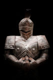 Knight holding sword in darkness Royalty Free Stock Photo