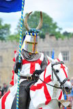 Knight upon horse bearing flag Royalty Free Stock Photography