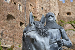Knight with horse in front of a castle. Knight with horse in front of Mont Orgueil Castle in Gorey, Jersey, UK Royalty Free Stock Image