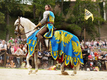 Medieval Knight Horse Riding, Prague Castle. Medieval Knight - horse riding in historic costume at Prague Castle. Czechia stock photo