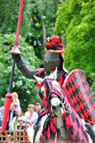 Knight upon horse ready for combat with lance Royalty Free Stock Image