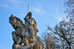 Knight on a horse. Statue of a templar Knight on a horse killing a dragon (st Joris Stock Photo