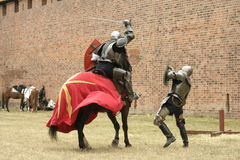 Knight on horse. With weapon in hand Royalty Free Stock Images