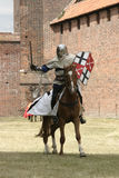 Knight on horse. With weapon in hand Stock Images