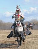 The knight on horseback. And holding in a hand an axe Stock Photography