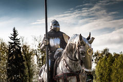 Knight on horseback. Horse in armor with knight holding lance. Horses on the medieval battlefield Royalty Free Stock Photo