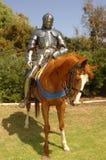 Knight on horseback vertical. 15th century knight in shining armour on horseback Stock Photo