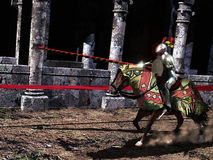 Knight jousting. Knights jousting near monumental antique columns Royalty Free Stock Photo