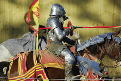 Knight Jousting. Knight on horseback in a jousting competition Stock Photo