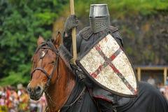 Knight with lance on horseback Royalty Free Stock Image