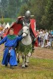 Knight with lance on horseback Stock Images
