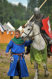 Knight with lance on horseback Stock Images
