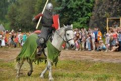 Knight with lance on horseback Stock Image