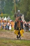 Knight with lance on horseback Stock Photos