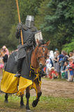 Knight with lance on horseback Stock Photography