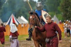 Knight with lance on horseback Stock Photo