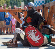 Knight looking at the judge pending a decision on the outcome of the battle. Ukrainian-Polish tournament of historical medieval battle. Maxim Gorky Central Park Royalty Free Stock Images