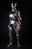 Knight. In metal armor on black background Royalty Free Stock Photography