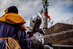 Knight in modern city Royalty Free Stock Photography