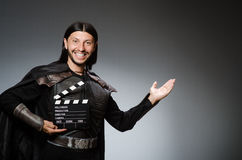 Knight with the movie Royalty Free Stock Photo