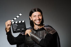 Knight with the movie board Royalty Free Stock Images