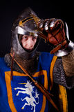 Knight with open helmet. Picture of glory knight opening his helmet Royalty Free Stock Photo