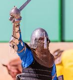 Knight - participant in knight festival welcomes spectators before the battle in Goren park in Israel. Goren, Israel, April 06, 2018 : Knight - participant in Stock Photo