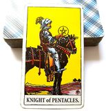 Knight of Pentacles Tarot Card   Building a Business/Empire Business Man Investing in Future. Commitment Hard Worker Disciplined Patient Great Effort Toil for Stock Photo