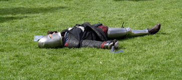 Knight playing dead. After a mock battle at Warkworth castle Stock Photography