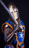 Knight posing with sword. Brave knight is ready for battle Royalty Free Stock Photo