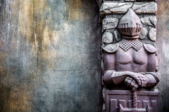 Knight Protectors Stone Statues and Cracked Grunge Wall Background Royalty Free Stock Photo