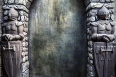 Knight Protectors Stone Statues and Cracked Grunge Wall Background Royalty Free Stock Photos
