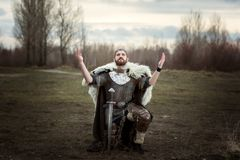 Knight raised his hands to the sky in entreaties. Stock Image