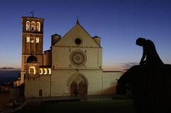 The knight return. In Assisi, during the sunset, the silhouette of a sad knight, figuring Saint Francesco, riding towards his new holy life Royalty Free Stock Photos