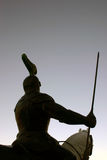 Knight rider. A silhouette of a knight riding his horse, armed and ready for battle stock image