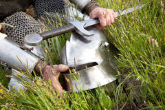 Knight's hands, helmet,  sword Royalty Free Stock Images