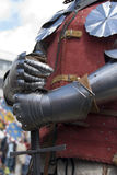 Knight's hands holding a sword Stock Images