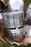 Knight's Helmet. Shining armor helmet knight lying on the skin of the deer during  the medieval festival Stock Photos
