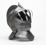 Knight's helmet. Image of a knight's metal helmet on a white background Royalty Free Stock Image
