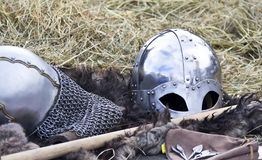 Knight's helmet. On a background of hay Stock Photo