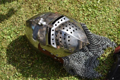 Knight`s helmet bascinet with face guard visor klappvisor and chainmail protection aventail, camail. Closeup view Stock Image