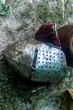 Knight`s helmet on the ground in day stock photos