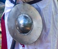 Knight`s little shield on a belt day stock photography