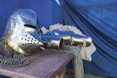 Knight`s medievil body armor. Medieval body armor on wooden table Royalty Free Stock Image