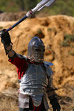 Knight's Victory. A knight raises his weapon in victory Stock Image