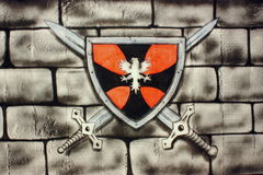 Knight shield. Logo of knight shield painted on a wall with bricks - airbrush Stock Photo